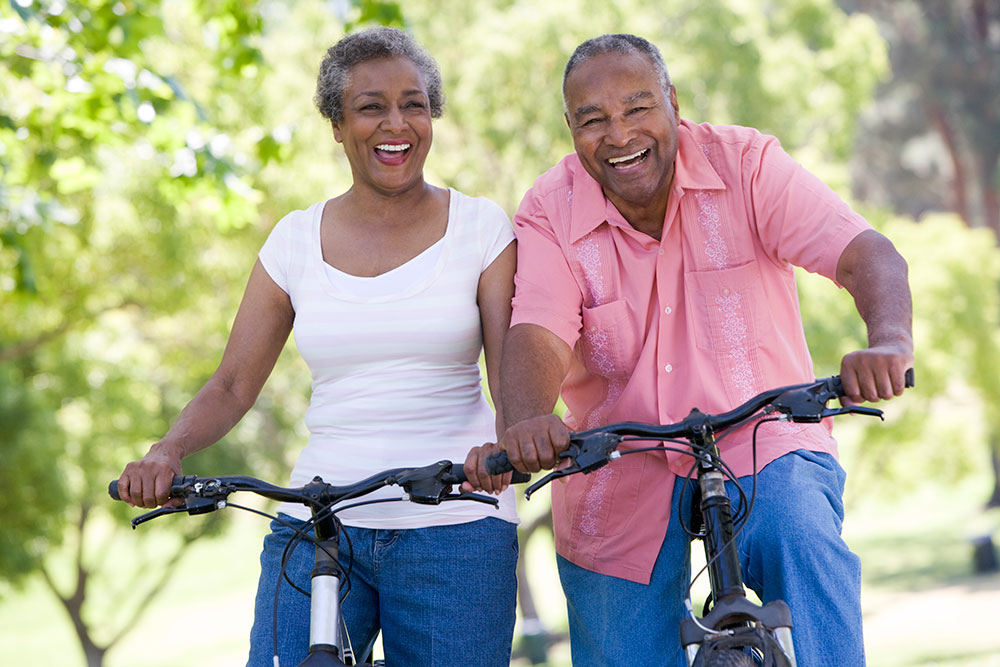Elderly Couple Biking Together